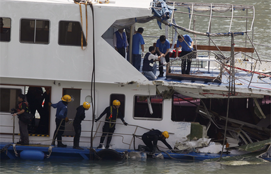 Police arrested six crew of the two ships, one a passenger ferry and the other a private pleasure cruiser.