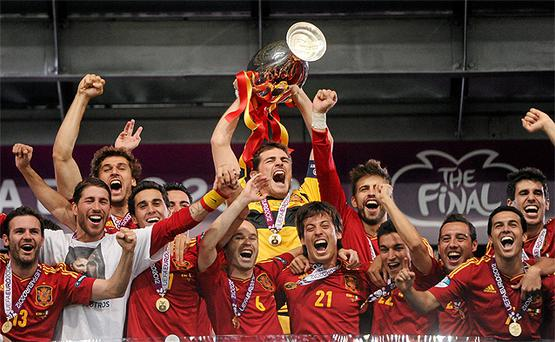 Spain became the first team to win three major international football tournaments in a row when they thrashed Italy 4 - 0 in the final of Euro 2012