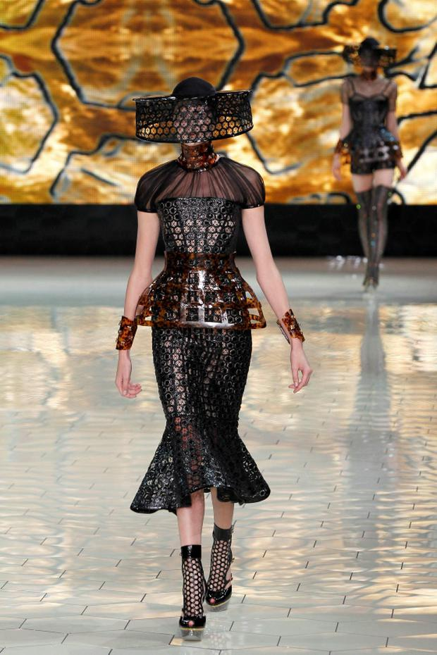 A model presents a creation by British designer Sarah Burton as part of her Spring/Summer 2013 women's ready-to-wear fashion show for fashion house Alexander McQueen during Paris Fashion Week October 2, 2012. REUTERS/Gonzalo Fuentes (FRANCE - Tags: FASHION ENTERTAINMENT)