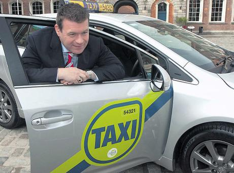 Junior Transport Minister Alan Kelly welcoming the new taxi branding initiative at Dublin Castle