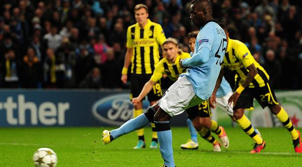 Manchester City's Mario Balotelli equalises from the penalty spot during the Champions League clash with Borussia Dortmund at the Etihad Stadium