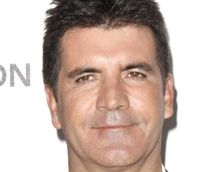 Recognisable face poll...Embargoed to 0001 Monday June 18File photo dated 07/03/10 of Simon Cowell who has come second in a poll to find the most recognisable faces in history. PRESS ASSOCIATION Photo. Issue date: Monday June 18, 2012. The poll, commissioned by television channel Yesterday to mark the launch of their series Museum Secrets. See PA story SHOWBIZ Cowell. Photo credit should read: PA Wire ...A
