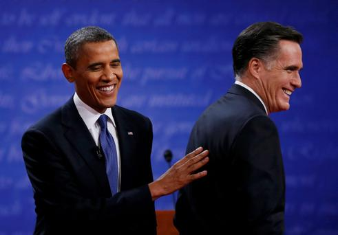 President Barack Obama (L) and Republican presidential nominee Mitt Romney share a laugh at the end of the first presidential debate in Denver October 3, 2012. REUTERS/Jim Bourg (UNITED STATES - Tags: POLITICS ELECTIONS USA PRESIDENTIAL ELECTION TPX IMAGES OF THE DAY)