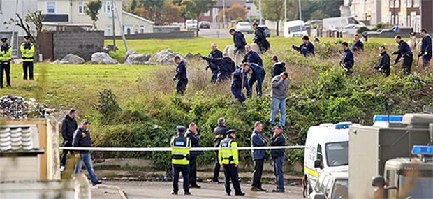 Members of a Garda search team at a halting site neal Belcamp