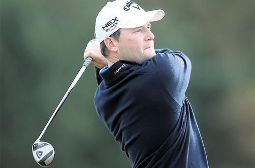Branden Grace hits an apporach shot to the ninth green on his way to shooting 60 Kingsbarns Links