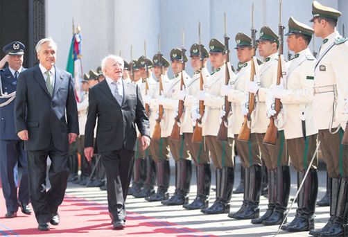 President Michael D Higgins with Chilean President Sebastian Pinera and laying a memorial wreath at the monument to General Bernardo O'Higgins in Santiago.