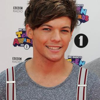 Louis Tomlinson of One Direction says he wants to avoid the typical 'boyband reputation'