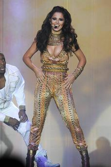 Cheryl wore a golden plunging jumpsuit for one dance routine.