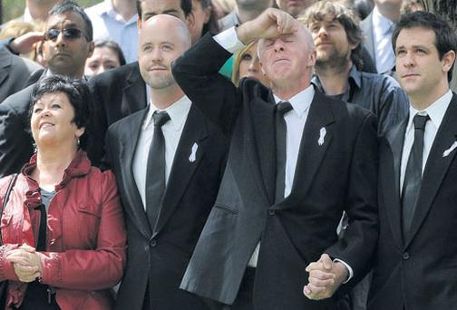 JILL Meagher's father George is overcome by grief as he and his wife Edith, son Michael and Jill's husband Tom, right, watch a flock of doves fly away at the end of her funeral at Fawkner Memorial Park in Melbourne yesterday