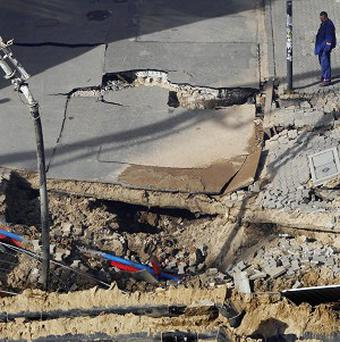 Part of a street collapsed during the construction of a new line of the underground railway in Warsaw (AP)