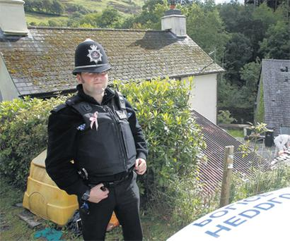 House searched: A policeman outside the home of murder accused Mark Bridger