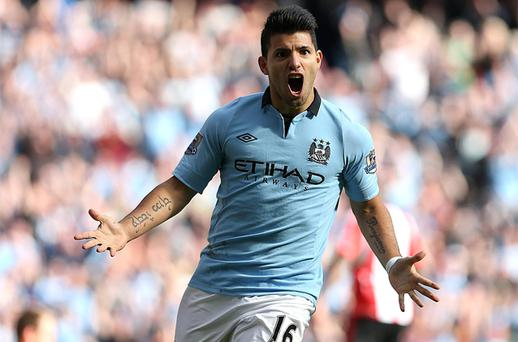 Manchester City's Sergio Aguero celebrates after scoring the second goal