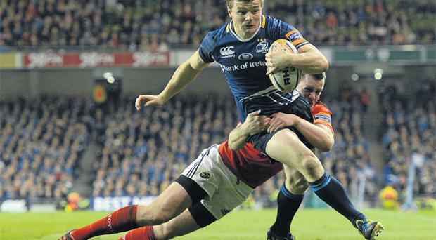 Brian O'Driscoll breaks the tackle of Keith Earls on his way to scoring a try