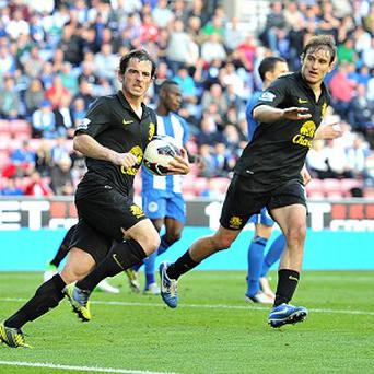 Leighton Baines, left, celebrates scoring Everton's second goal from the penalty spot