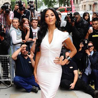 Nicole Scherzinger has said she sang most of the Pussycat Dolls' first album on her own
