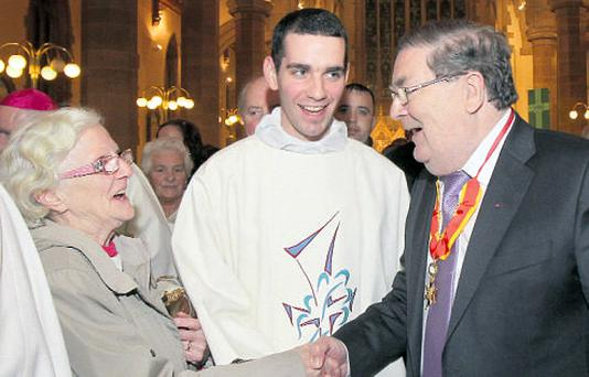 John Hume greets well-wishers at his Papal Knight ceremony in Derry