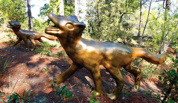 Bronze foxes sculpted by Michael Stipe, former lead singer of REM, at Chateau La Coste, near Aix-en-Provence in the south of France