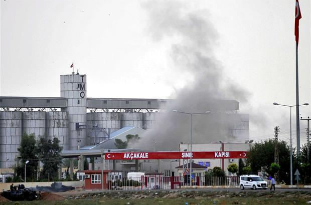 Smoke rises at the Akcakale border gate after a shell fired from Syria landed on the Turkish-Syrian border in Sanliurfa province