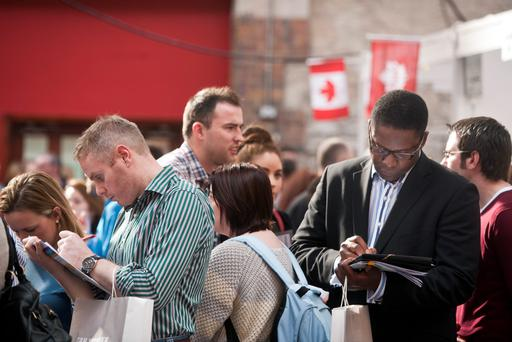 People filling out job application forms at the Working Abroad Expo in the RDS yesterday.Pic:Mark Condren7.10.2012