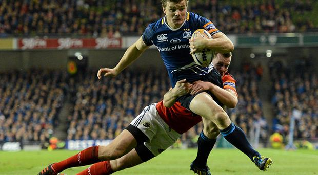 Brian O'Driscoll gets past the tackle of Keith Earls