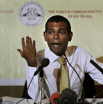 Former Maldives president Mohamed Nasheed is facing arrest (AP)