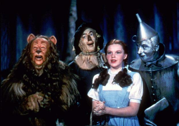 FILE- This 1939 file photo provided by Warner Bros. shows, from left, Bert Lahr as the Cowardly Lion, Ray Bolger as the Scarecrow, Judy Garland as Dorothy and Jack Haley as the Tin Woodman in a scene from