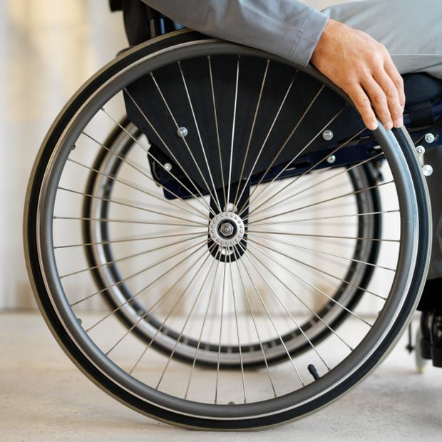 close up mid section view of a man sitting in a wheelchair