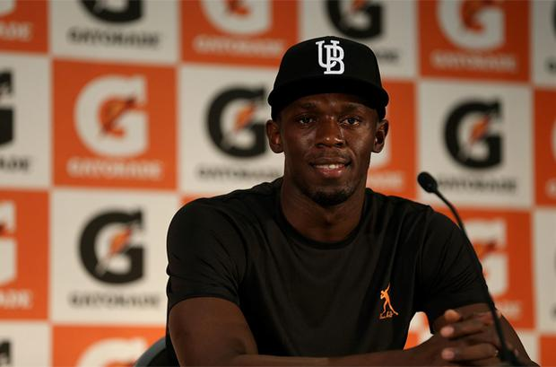 Jamacian Olympic gold medallist Usain Bolt attends a press conference before coaching a track and field clinic at AUT Millenium in Auckland