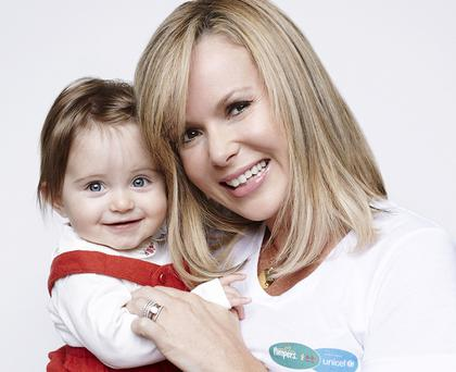 Undated Pampers handout photo of TV star Amanda Holden showing off smiling daughter Hollie, ten months after the birth which left the Britain's Got Talent judge fighting for her life, for the launch the Picture A Better Future Campaign to help cut the incidence of newborns suffering from tetanus. PRESS ASSOCIATION Photo. Issue date: Monday October 8, 2012. The actress was pictured with her second daughter to encourage other mums to post pictures of their children online to raise money for vaccinations in a project which has seen Unicef team up with nappy brand Pampers. See PA story SHOWBIZ Holden. Photo credit should read: Pampers/PA Wire NOTE TO EDITORS: This handout photo may only be used in for editorial reporting purposes for the contemporaneous illustration of events, things or the people in the image or facts mentioned in the caption. Reuse of the picture may require further permission from the copyright holder.