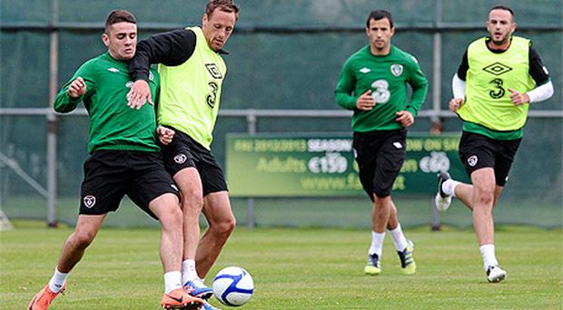 Robbie Brady, left, and David Meyler during squad training ahead of Ireland's World Cup qualifier against Germany on Friday