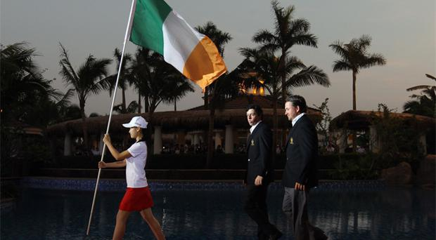 Rory McIlroy and Graeme McDowell walk behind the Irish flag at the Opening Ceremony of the Omega Mission Hills World Cup in 2011 in China