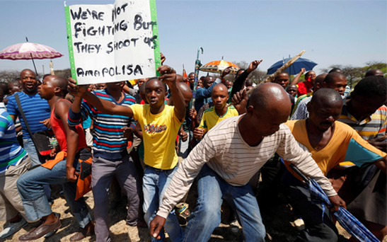 South Africa's striking miners warned of more violence this weekend as platinum giant Amplats fired 12,000 workers.