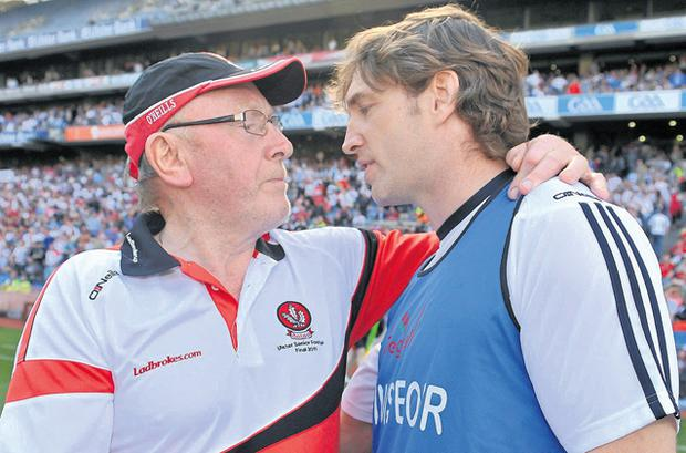 The end of John Brennan's reign in Derry marked a significant milestone for Gaelic football where young managers, spearheaded by Kildare boss Kieran McGeeney (R), are increasingly taking the reins of inter-county teams