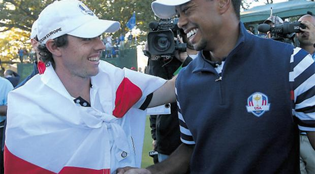 Tiger Woods congratulates Rory McIlroy after Europe's Ryder Cup victory