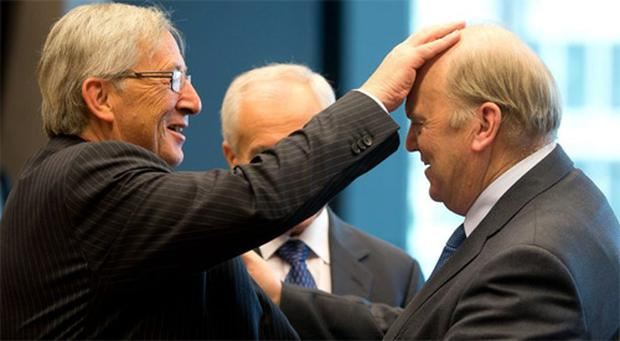 Finance Minister Michael Noonan meets Jean-Claude Juncker, president of the Eurogroup, at the European Stability Mechanism (ESM) meeting of EU euro area finance ministers yesterday