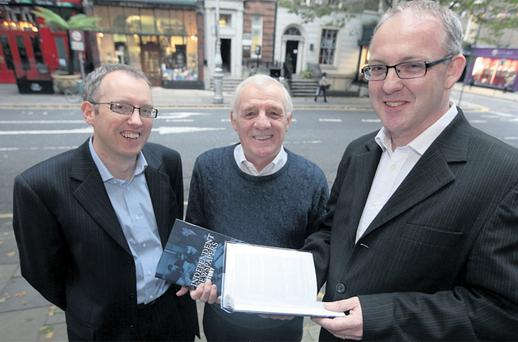 Eamon Dunphy with authors Mark O'Brien (left) and Kevin Rafter at the book launch of 'Independent Newspapers: A History', at the Royal Irish Academy in Dublin