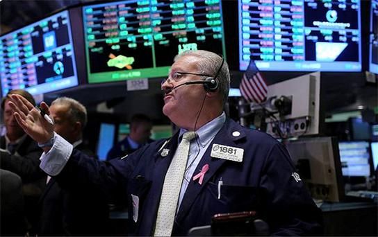 Traders await the release of third-quarter results in the USA today. (Photo: Getty Images)