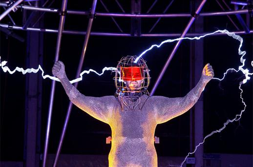 Magician David Blaine channels bolts of electricity from various tesla coils charged with one million volts of electricity during a stunt on Pier 54 in New York