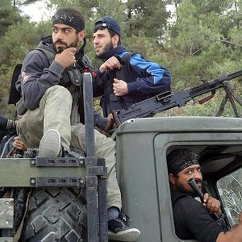 Free Syrian Army fighters on the Turkish border (AP)