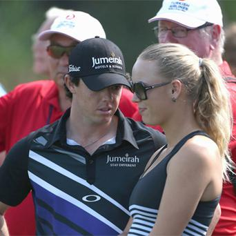 Rory McIlroy with his girlfriend Caroline Wozniacki during day one of the Turkish Airlines World Golf Final.