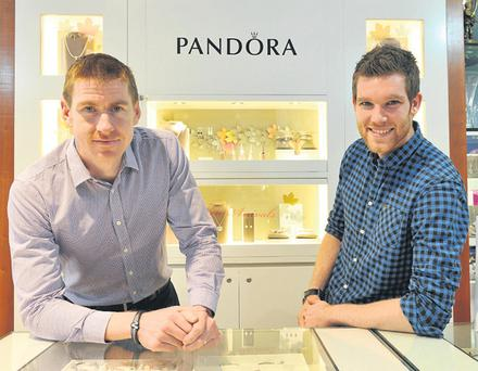 Bryan McCrystal, left, an Irish triathlon champion, and Stephen Ralph, right, a marathon runner and triathelete, in Baldwin's jeweller's
