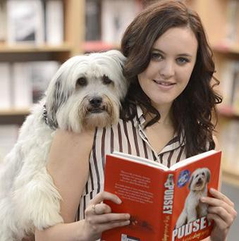Canine Britain's Got Talent star Pudsey helps launch his book with owner Ashleigh Butler