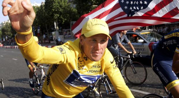 Armstrong of U.S. waves during the rider's parade after the final stage of the Tour de France in Paris...US Postal rider Lance Armstrong of the United States, the first six-time winner of the Tour de France cycling classic, waves to supporters during the rider's parade on the Champs-Elysees after the 20th and final stage of the Tour in Paris, July 25, 2004. Armstrong won the Tour de France for a record-breaking sixth time on Sunday. REUTERS/Wolfgang Rattay...S