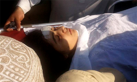 Malala Yousufzai (14) was unconscious in critical condition after being shot in the head and neck as she left school, but doctors said she had moved her arms and legs slightly.
