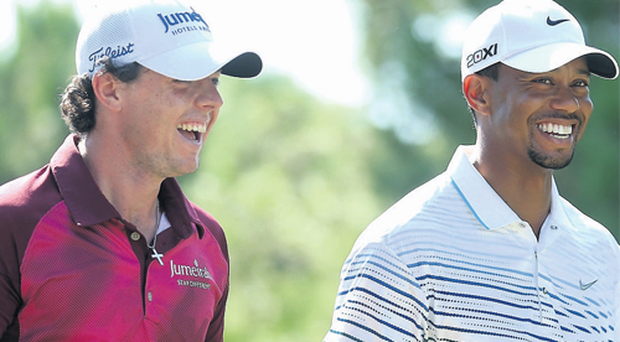 Rory McIlroy shares a joke with Tiger Woods on the way to a six-shot defeat to the American at Antalya GC in Turkey.