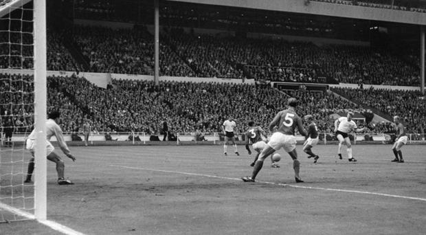 Helmut Haller puts West Germany 1-0 ahead during the World Cup Final against England at Wembley Stadium. Photo: Getty Images