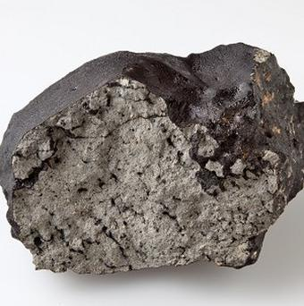 A chunk of the Tissint Martian meteorite is on display at the Natural History Museum in London