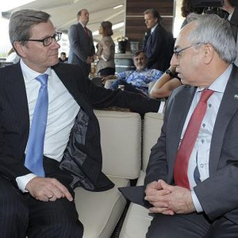 Abdelbaset Sieda, head of the Syrian National Council, right, and German foreign minister Guido Westerwelle at the forum in Istanbul, Turkey (AP)