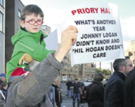 PROTEST: Priory Hall residents attend a rally at the apartments yesterday. Photo: Tony Gavin