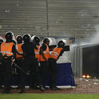 Police try to clear rioting Senegal fans at Leopold Sedar Senghor Stadium in Dakar, Senegal (AP/Rebecca Blackwell)
